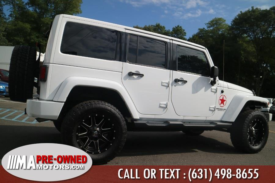 2013 Jeep Wrangler Unlimited 4WD 4dr Sahara, available for sale in Huntington, New York | M & A Motors. Huntington, New York