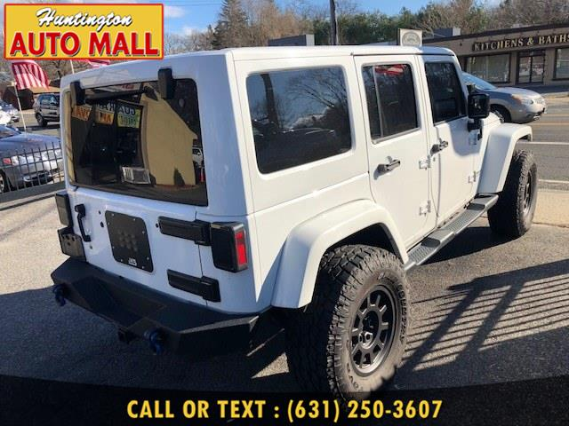 2014 Jeep Wrangler Unlimited 4WD 4dr Sahara, available for sale in Huntington Station, New York | Huntington Auto Mall. Huntington Station, New York