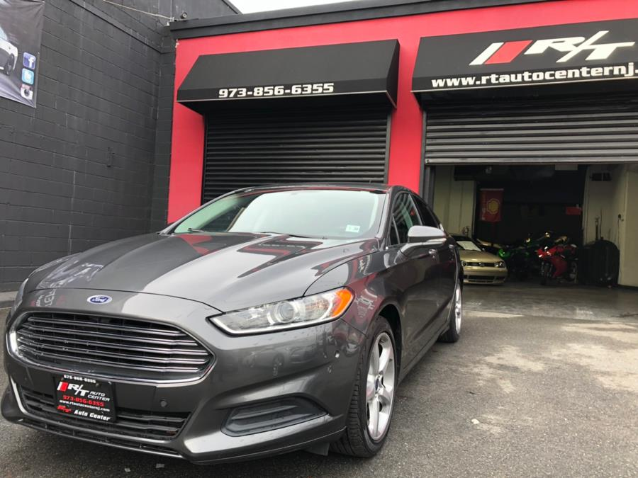 2015 Ford Fusion 4dr Sdn SE FWD, available for sale in Newark, New Jersey | RT Auto Center LLC. Newark, New Jersey