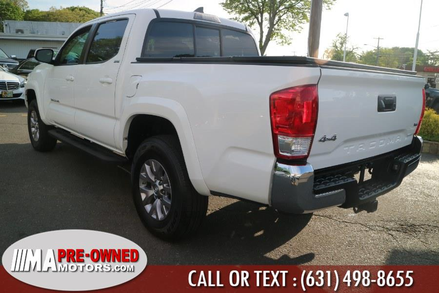 2016 Toyota Tacoma 4WD Double Cab V6 AT SR5 (Natl), available for sale in Huntington, New York   M & A Motors. Huntington, New York