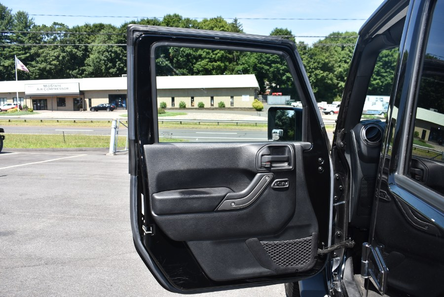 2016 Jeep Wrangler Unlimited 4WD 4dr Sport, available for sale in Berlin, Connecticut | Tru Auto Mall. Berlin, Connecticut