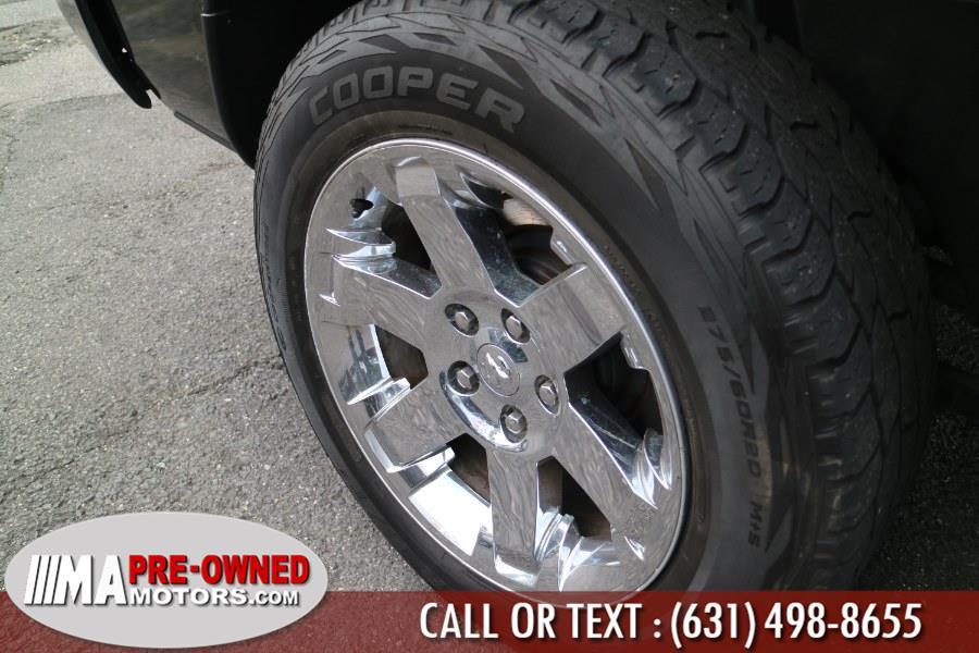 "Used Ram 1500 4WD Quad Cab 140.5"" Express 2014   M & A Motors. Huntington, New York"