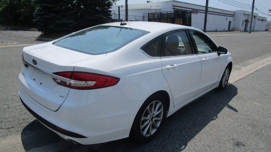 2017 Ford Fusion SE FWD, available for sale in Hicksville, New York | H & H Auto Sales. Hicksville, New York