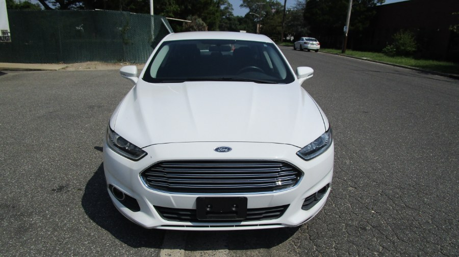 2016 Ford Fusion 4dr Sdn SE FWD, available for sale in Hicksville, New York | H & H Auto Sales. Hicksville, New York