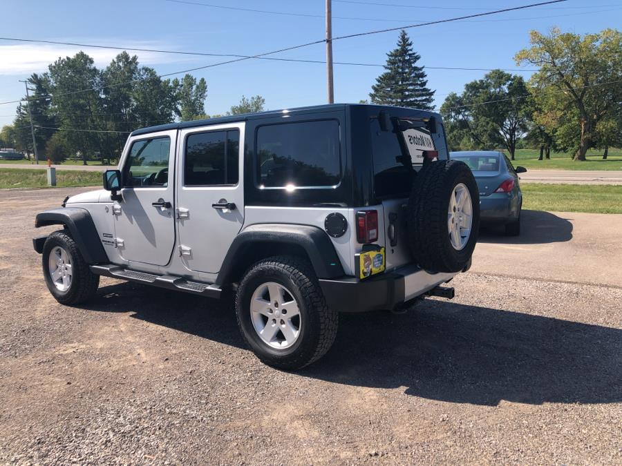 2010 Jeep Wrangler Unlimited 4WD 4dr Sport, available for sale in Davison, Michigan | KVI Motors. Davison, Michigan
