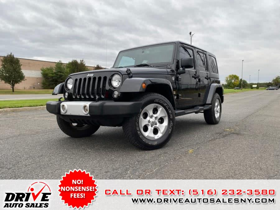 Used 2015 Jeep Wrangler in Bayshore, New York | Drive Auto Sales. Bayshore, New York