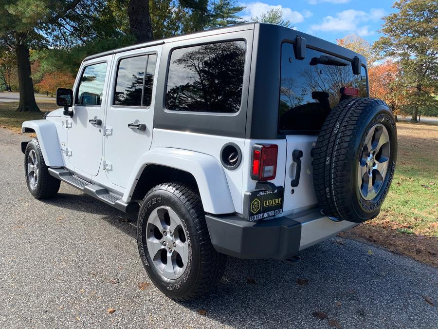 2017 Jeep Wrangler Unlimited Sahara Smoky Mountain 4x4, available for sale in Franklin Square, New York | Luxury Motor Club. Franklin Square, New York