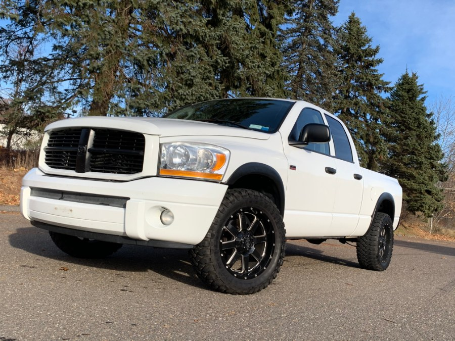 2006 Dodge Ram 1500 4dr Quad Cab 140.5 4WD SLT, available for sale in Waterbury, Connecticut | Platinum Auto Care. Waterbury, Connecticut