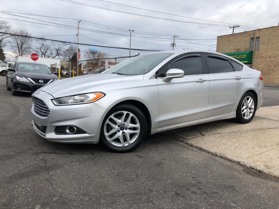 2014 Ford Fusion 4dr Sdn SE FWD, available for sale in Franklin Square, New York   Signature Auto Sales. Franklin Square, New York